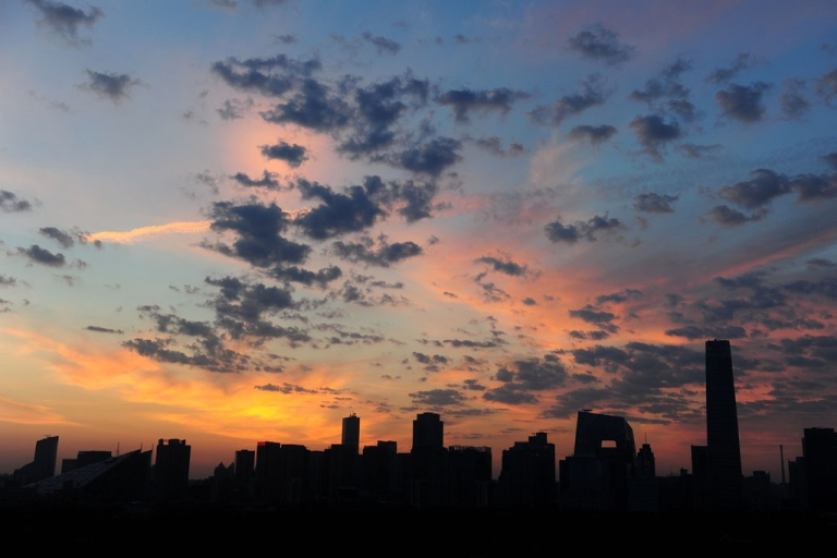 <p>A new day breaks in Beijing on June 25, 2011 behind the central business district skyline with the city's tallest building, the China World Trade Tower 3.</p>