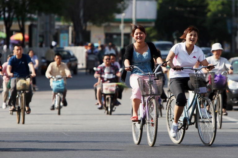 <p>Cyclists make their way along a street in Beijing on May 25, 2010. With road congestion and air pollution ever worsening, officials in various Chinese cities are trying to revive once-thriving bicycle culture by offering a bike-share programs, similar to those seen in Europe and the United States.</p>