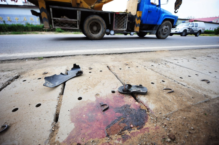 <p>China's roads are among the world's most dangerous, with traffic laws and safety widely flouted, as almost 70,000 people died in road accidents in 2009, or around 190 fatalities a day, according to police statistics.</p>