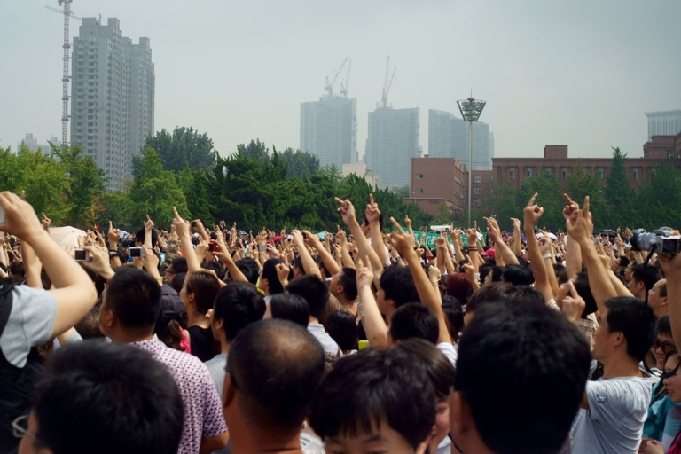 <p>Chinese protesters demonstrate against the building of the Fujia chemical plant in Dalian, in northeast China's Liaoning province on Aug. 14, 2011.</p>