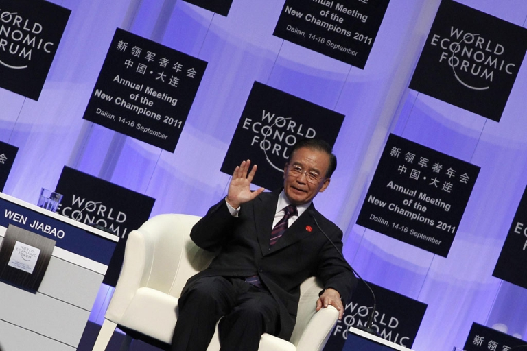<p>China's Premier Wen Jiabao delivers his keynote address at the summer session of the World Economic Forum in the Chinese port city of Dalian, northeast China's Liaoning province on Sept. 14, 2011.</p>