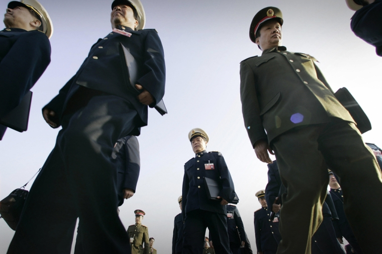 <p>Chinese People's Liberation Army and Navy delegates arrives at the Great Hall of the People in Beijing.</p>