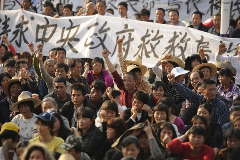 <p>Residents of Wukan, a fishing village in the southern province of Guangdong, rally to demand the government take action over illegal land grabs and the death in custody of a local leader on Dec. 15, 2011.</p>