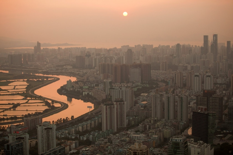 <p>The Shenzhen river dividing Hong Kong and Shenzen stretches into the distance on November 28, 2010 in Shenzhen, China. According to the US Commercial Service, Shenzhen is one of the fastest growing cities in the world.</p>