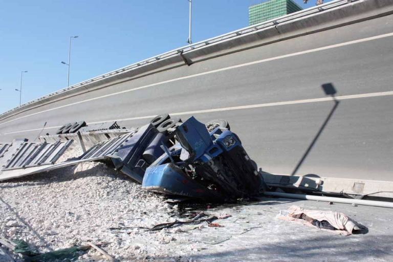 <p>A body lies near to a crushed truck, situated under a collapsed eight-lane suspension bridge in Harbin, northeast China's Heilongjiang province on Aug. 24, 2012.</p>