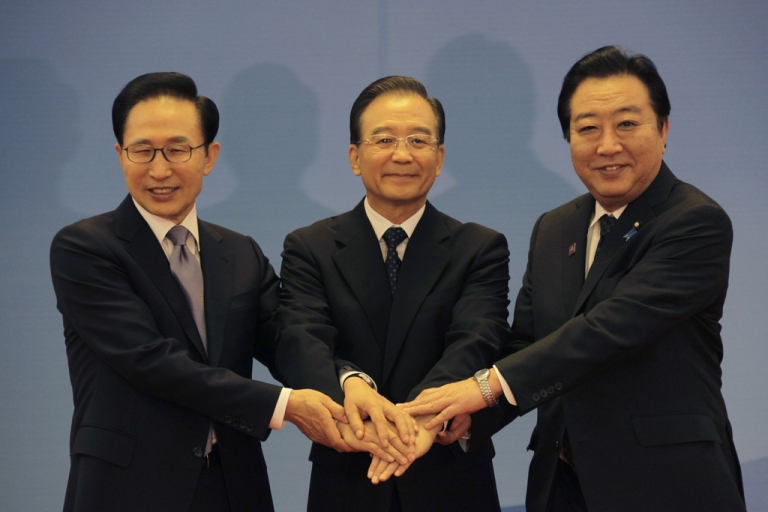 <p>(Left to right) South Korean President Lee Myung-bak, China Premier Wen Jiabao and Japanese Prime Minister Yoshihiko Noda pose for photographs at the Great Hall of the People May 13, 2012 in Beijing, China.</p>