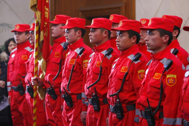 <p>Members of the Chinese rescue team prepare to depart to aid Japan, after the earthquake and tsunami, at the airport in Beijing on March 13, 2011. Premier Wen Jiabao expressed his