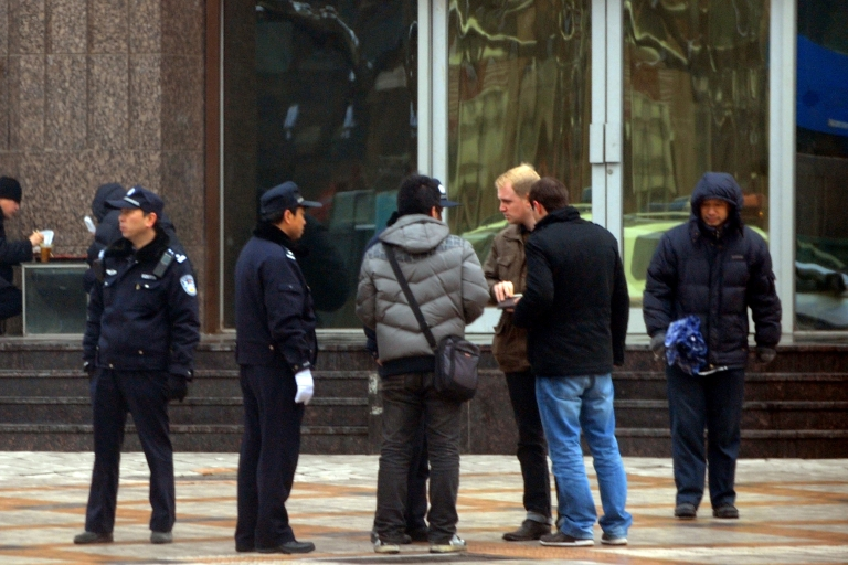 <p>Chinese police surround a group of foreign journalists as security is ramped up, with at least 300 hundred uniformed police guarding the entrance to the Jasmine rally site, designated in an online appeal, in the Wangfujing shopping street in central Beijing on Feb. 27, 2011. Citizens have been urged in an online appeal to gather each Sunday for