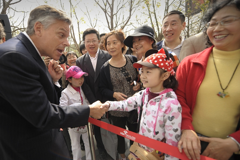 <p>US Ambassador to China Jon Huntsman (left) greets visitors at the opening of the US pavilion on the first day of the World Expo 2010 in Shanghai on May 1, 2010. (Peter Parks/AFP/Getty Images)</p>