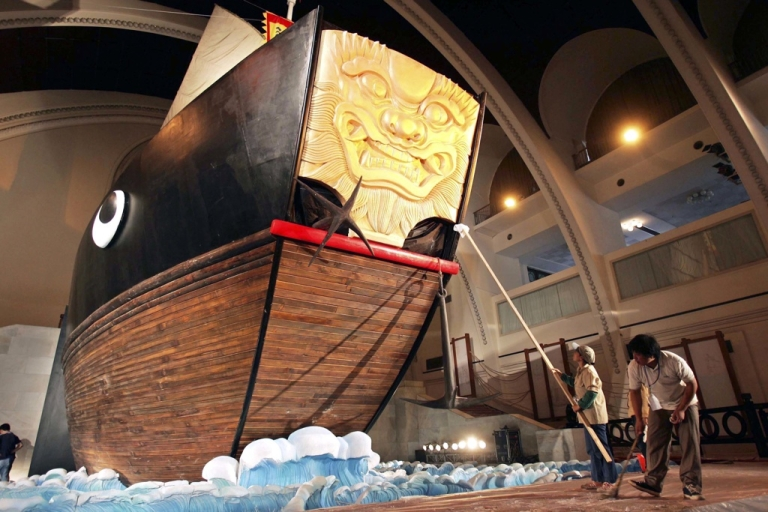 <p>Workers clean a model of a Chinese ship sailed by Chinese explorer Zheng He. He led seven seven voyages in which he sailed from China to more than 30 countries and regions throughout the Indian Ocean and Persian Gulf from 1405 to 1433.</p>