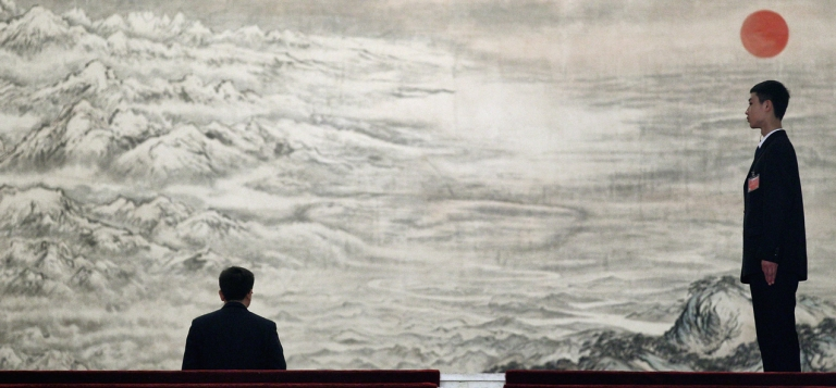 <p>Security officers stand guard in front of a Chinese ink painting during the opening ceremony of the National People's Congress (NPC) at the Great Hall of the People on March 5, 2012 in Beijing.</p>