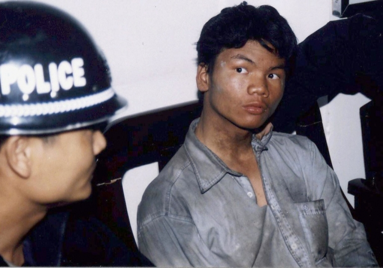 <p>Suspected murderer Ma Jiajue, 23, in police custody after he was arrested in Sanya city, southern China's Hainan province, Mar. 15, 2004.  Ma is suspected of killing four of his university classmates and stuffing their bodies into a dormitory closet where they were found days later decomposing, as China has been shocked by a spate of murders over the past four months including the high-profile case of a serial killer responsible for the deaths of 67 people.</p>
