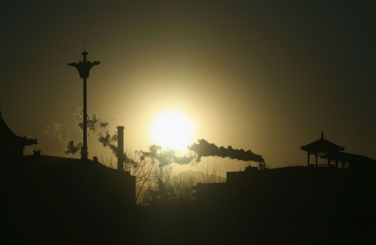 <p>Chimneys belch out smoke at the Beijing Capital Steel Plant , which has long been blamed as Beijing's worst polluter, on January 31, 2007 in western suburbs of the Chinese capital.</p>