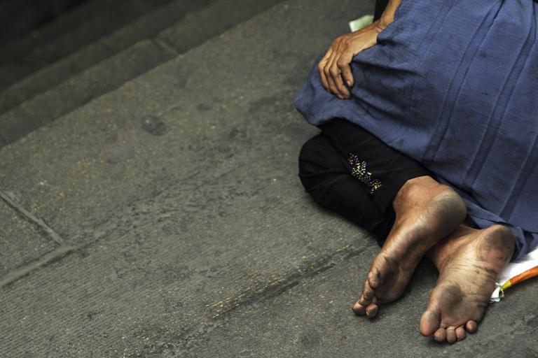 <p>A homeless Muslim Uighur woman sleeps in Urumqi on July 5, 2010.</p>