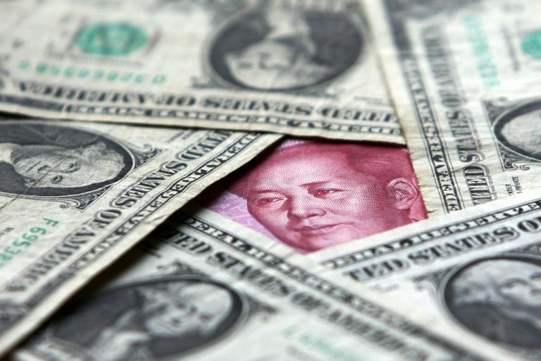 <p>Dollars and yuan notes.</p>