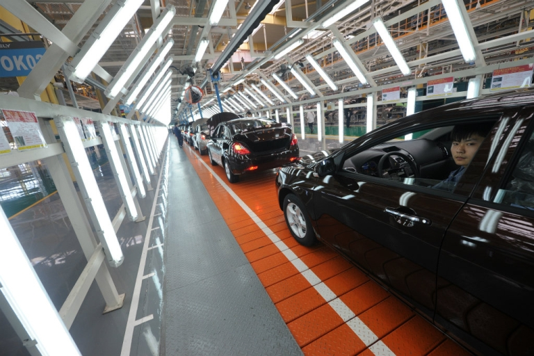 <p>A Chinese Geely Motors employees sits in a completed car at their manufacturing plant in Cixi, 50km from Ningbo in China's Zhejiang province. Chinese manufacturing activity hit a seven-month low in June, putting pressure on Beijing to do more to boost the world's second-largest economy.</p>