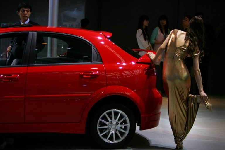 <p>A model relaxes her foot beside a Buick during the Auto China 2008 show April 20, 2008 in Beijing, China.</p>