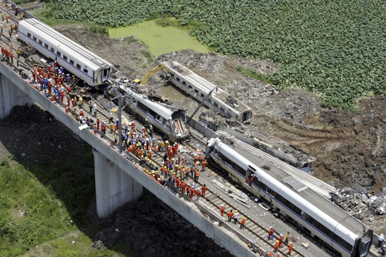 <p>This aerial photo taken on July 24, 2011 shows rescue operations continuing on the wreckages of two high-speed trains that collided the night before in the town of Shuangyu, on the outskirts of Wenzhou in the eastern Chinese province of Zhejiang. China has ordered an 'urgent' overhaul of rail safety, state media said Sunday, after 43 people were killed in the worst accident ever to hit the country's high-speed train network. The collision of two trains in eastern China is likely to raise fresh questions over the rapid roll-out of the country's high-speed lines, the world's biggest at more than 5,000 miles.</p>