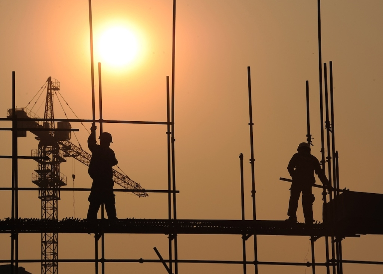 <p>This picture taken on September 26, 2012 shows workers on a scaffold at a construction site in Hefei, in central China's Anhui province. Beijing recently approved a massive infrastructure package as the government seeks to boost the flagging economy.</p>