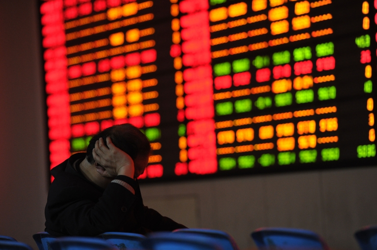 <p>A Chinese stock investor checks his share prices at a security firm in Hefei, east China's Anhui province on February 22, 2012.</p>
