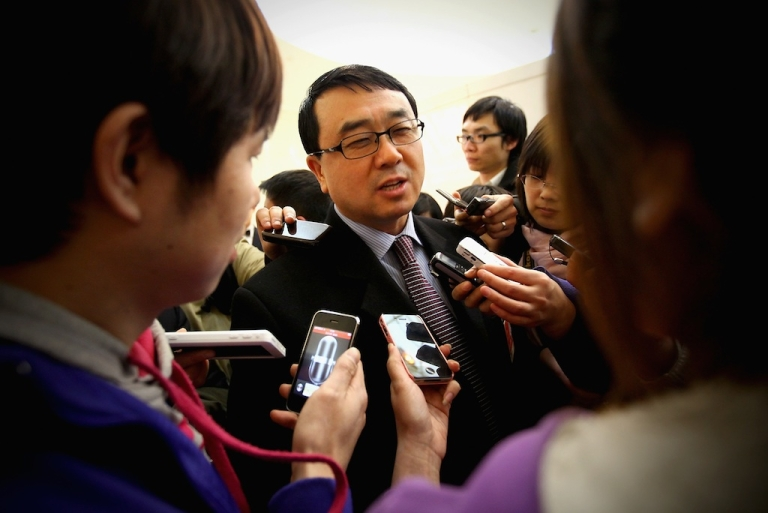 <p>Wang Lijun, the former Chongqing police chief, is questioned by reporters at the National People's Congress on March 6, 2011 in Beijing, China.</p>