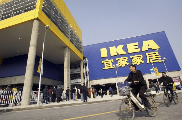 <p>Customers cycle past a real Ikea shop in Chengdu, China. On the heels of the discovery of fake Apple stores in China, a store with a close resemblance to Ikea has been found, also in the southwestern Chinese city of Kunming.</p>