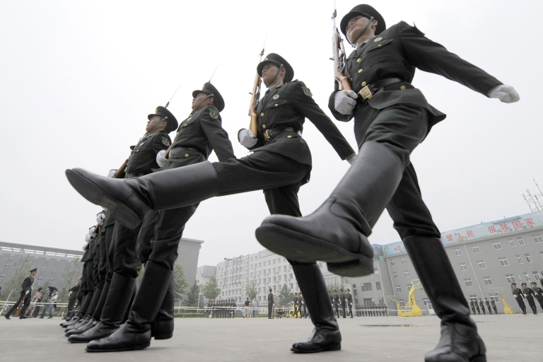 <p>Chinese soldiers practice drills at a barracks in Beijing on July 21, 2011. The Chinese government has been implicated in a massive series of cyber attacks on U.S. defense firms and other international organizations.</p>