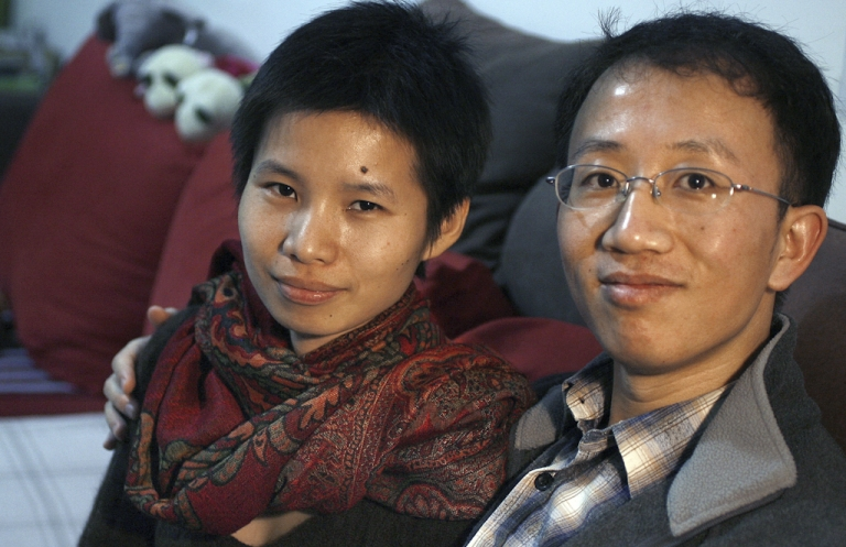 <p>This file photo taken on January 9, 2007 shows Chinese human rights activists Hu Jia (R) and his wife Zeng Jinyan (L) in their apartment on the outskirts of Beijing. Zeng, the wife of jailed Chinese rights activist Hu Jia, who is due to be freed this weekend, has said on June 21, 2011 she is back in her Beijing home after being apprehended and taken to visit her husband in prison. Zeng said on her Twitter account that she was taken away by eight unidentified people after landing at Beijing airport on June 19, 2011, but then was allowed to meet with Hu at the prison on June 20, 2011. Hu is due to be released on June 26, 2011 after serving three and a half years for subversion.</p>