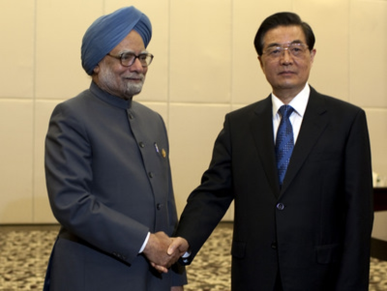 <p>Indian Prime Minister Manmohan Singh (L), is greeted by Chinese president Hu Jintao, on April 13, 2011 in Sanya, Hainan Province, China. Leaders from Brazil, Russia, India, China, and South Africa will meet on April 14 for the 2011 BRICS Summit, an annual gathering of the worlds five leading emerging nations.</p>