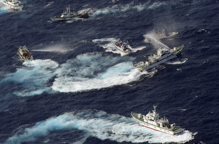 <p>A Japan Coast Guard vessel sprays water against Taiwanese fishing boats, while a Taiwanese coast guard ship also sprays water in the East China Sea near Senkaku Islands as known in Japanese or Diaoyu Islands in Chinese on September 25, 2012.</p>