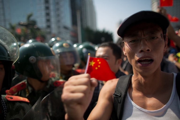 <p>Anti-Japanese protesters are confronted by police as they demonstrate over the disputed Diaoyu Islands, on Sept. 16, 2012 in Shenzhen, China. Protests have taken place across China in a dispute that is becoming increasingly worrying for regional stability.</p>