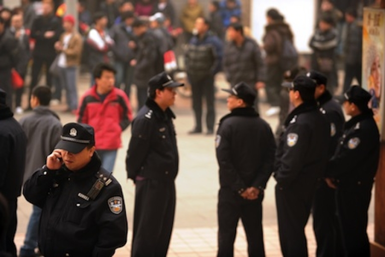 <p>Police keep watch in Beijing in February, 2011, after Internet postings called on disgruntled Chinese to gather in protest.</p>