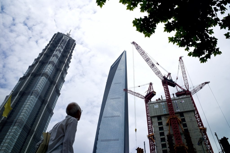<p>The building in the center is the 101-floor World Finance Center in Shanghai's Pudong district. China's construction boom and appetite for bold buildings have given architects the chance to push design boundaries, amid a slowdown in Europe and North America. But is China's boom sustainable?</p>