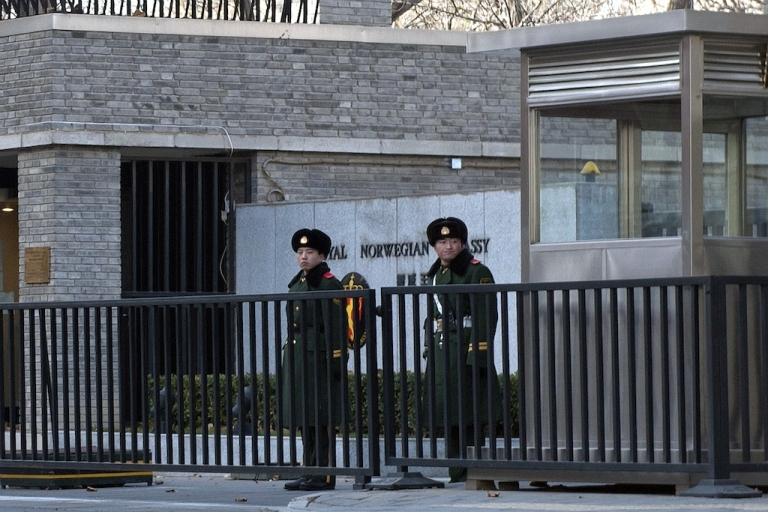<p>Two Chinese paramilitary guards stand outside the Norwegian embassy in Beijing on December 11, 2010. China lashed out at the 'political theatre' of the Nobel committee, saying its awarding the 2010 Peace Prize to jailed dissident Liu Xiaobo was a product of a 'Cold War mentality'.</p>