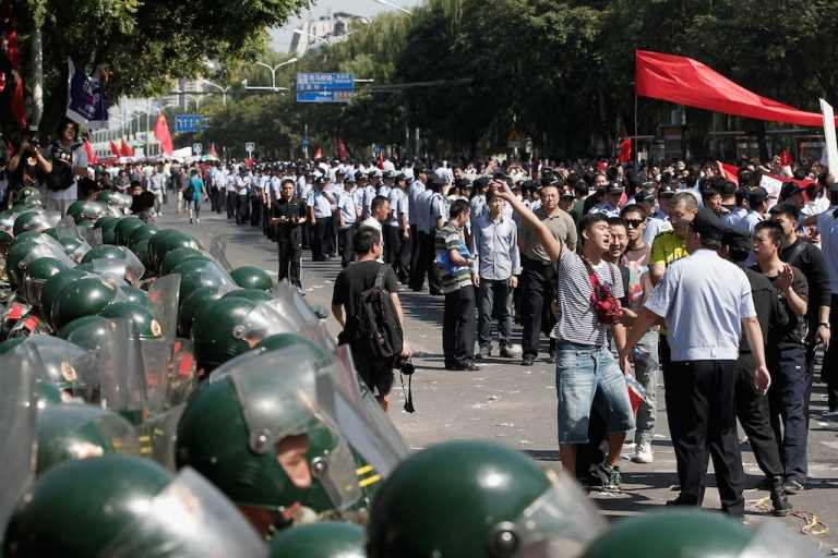 <p>Chinese demonstrators stage an anti-Japanese protest over the disputed Diaoyu Islands, known as the Senkaku Islands in Japan, outside the Japanese Embassy on September 15, 2012 in Beijing, China.</p>