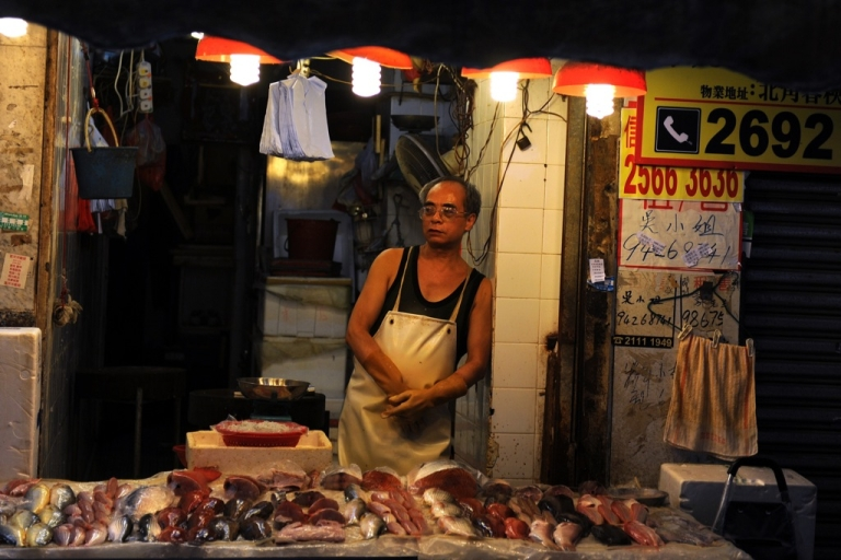 <p>A man works inside a fresh seafood shop at a wet market in Hong Kong on June 26, 2012. The wealth gap in Hong Kong, already one of the world's widest, is worsening as the rich get richer and the poor struggle to make ends meet, official figures show.</p>