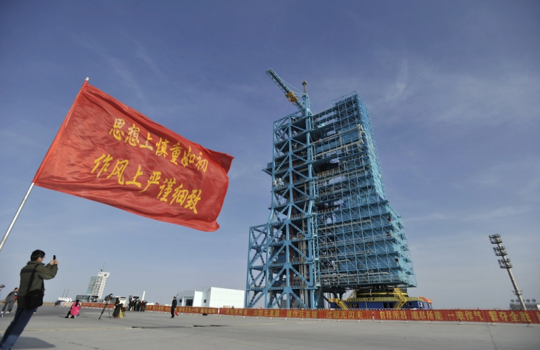<p>A man takes a photo of an upgraded Long March 2F rocket carrying the Shenzhou-8 spacecraft at the Jiuquan Satellite Launch Center in Jiuquan, northwest China's Gansu province on October 31, 2011. China said it will launch an unmanned spacecraft on November 1, taking its next step towards the goal of building its first space station by 2020.</p>