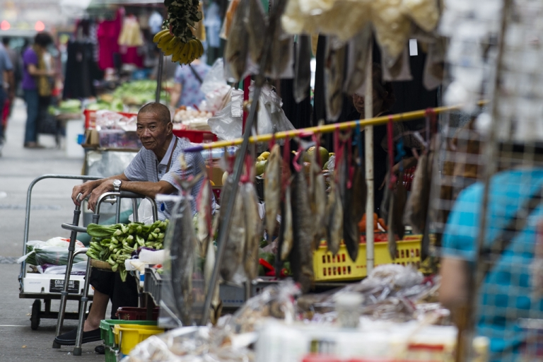 <p>A vegetable stall owner waits at his street side shop in Hong Kong on October 9, 2012. The IMF cut its growth forecasts for developing Asia, blaming a slowdown in Europe and the US, and warned that China's attempts to boost its economy had not taken hold.</p>