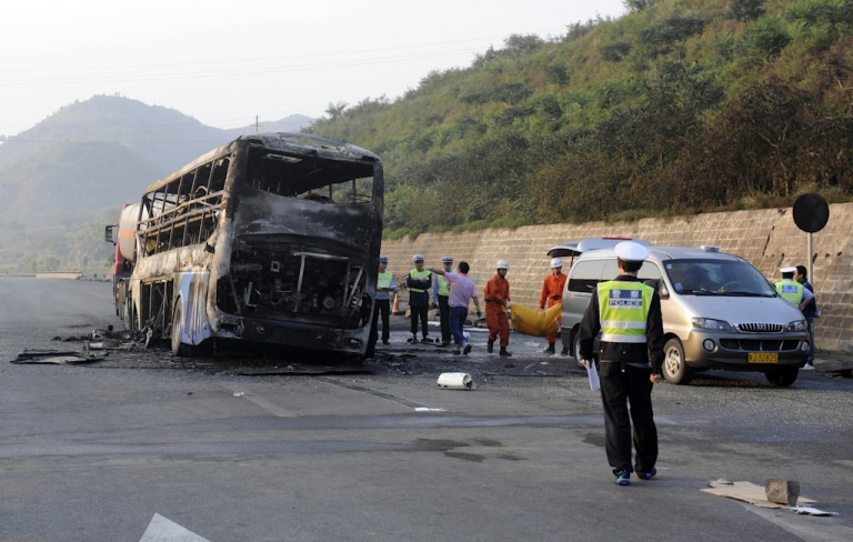 <p>Police and rescuers remove the bodies from a burnt out double-decker sleeper bus after a collision with a tanker near Yan'an in northern China's Shaanxi province on August 26, 2012.  At least 36 people died in the fiery collision between a methanol tanker and a double-decker sleeper bus in China's worst traffic accident in more than a year</p>