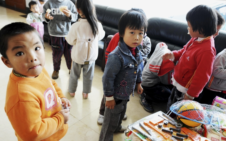 <p>A group of 60 children are waiting to reunite with their parents after police rescued them from human traffickers at Guiyang Welfare Center for Children in Guiyang, southwest China's Guizhou province on October 29, 2009. Police in China on July 27, 2011 said they had rescued 89 trafficked children and arrested 369 suspects after uncovering two child trafficking gangs.</p>