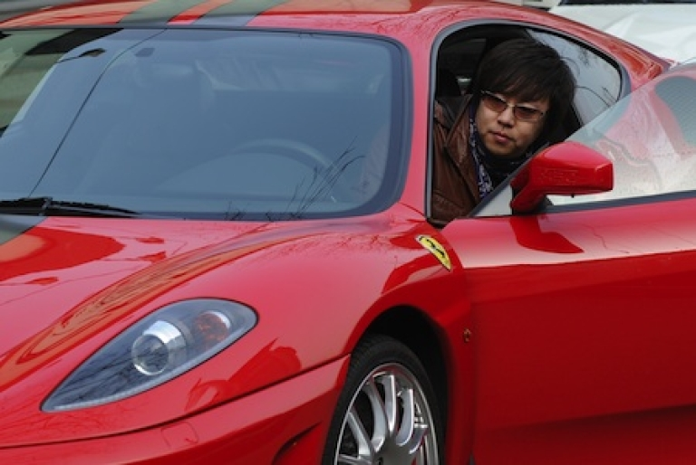 <p>Li Fu, 29, climbs into his Ferrari on a street in Beijing. Li is one side of China's yawning wealth gap between rich and poor, a by-product of the country's stunning economic transformation, and a ticking time bomb at the heart of the ruling Communist Party's plan to revamp the economy.</p>