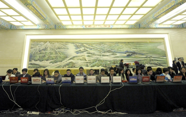 <p>Journalists from Chinese websites work on computers during a press conference of the Third Session of the 11th National People's Congress in Beijing on March 4, 2010. China is home to the world's largest web population, with 384 million people online. The country has more than 81,000 Internet cafes with 4.7 million computers.</p>