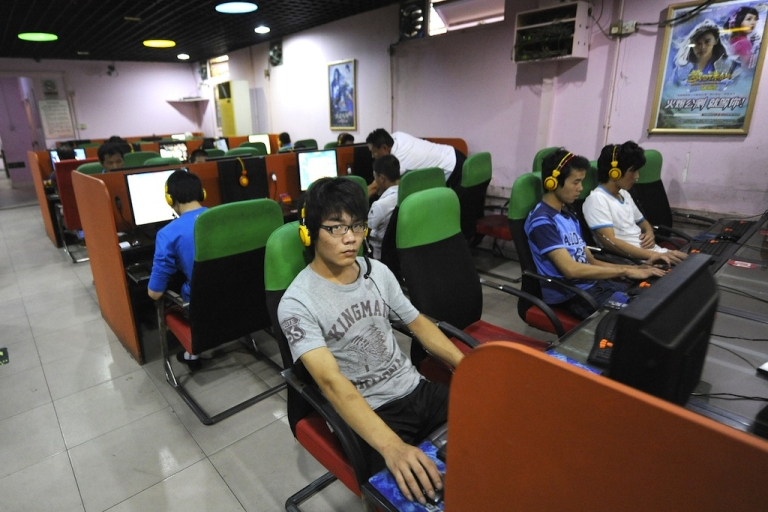 <p>A young man uses a computer at an internet bar in Beijing, China.</p>