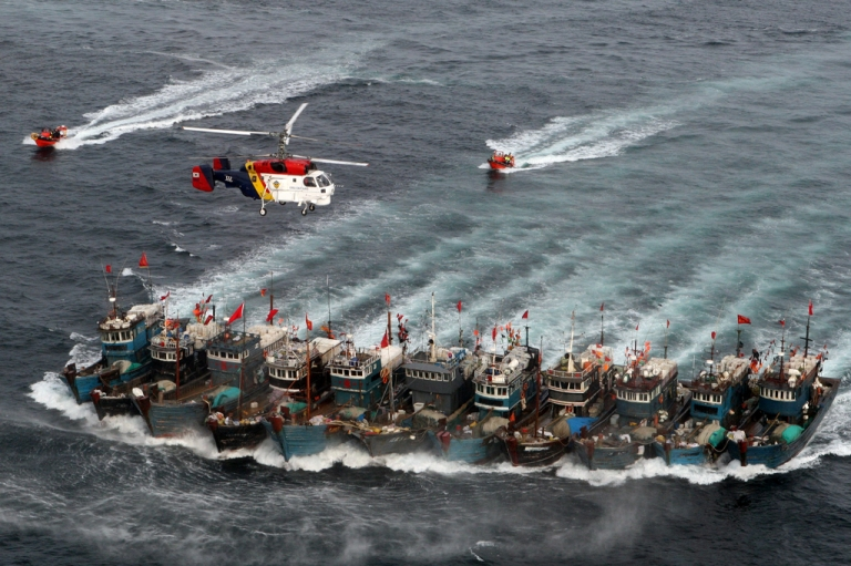 <p>A picture taken on November 16, 2011 from a South Korean helicopter shows Chinese boats banded together with ropes, chased by a coastguard helicopter and rubber boats pacted with commandoes, after alleged illegal fishing in South Korean waters in the Yellow Sea.</p>