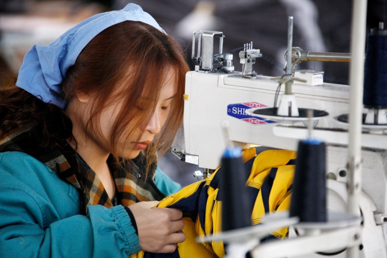 <p>A Chinese worker goes about her chores at a textile factory in Huaibei, east China's Anhui province on November 21, 2011. China's manufacturing activity slumped to its lowest level in 32 months in November, banking giant HSBC said, renewing fears the Asian powerhouse is losing steam amid global economic woes.</p>