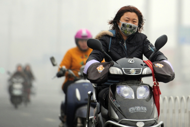 <p>Toxic smog is smothering China's capital again, reducing visibility to 200 yards in some areas of Beijing.</p>