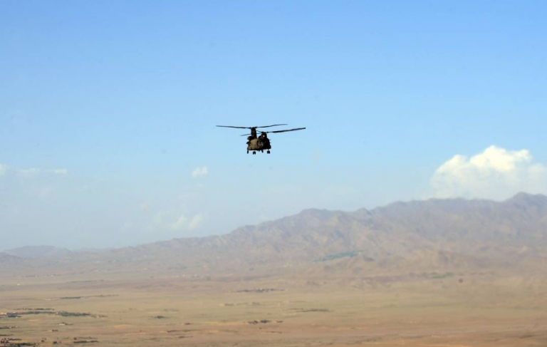 <p>A U.S. Chinook helicopter flies over a valley in Afghanistan. An Afghan official says the Taliban laid an elaborate trap for the Chinook they shot down on Friday, killing 38 troops including 30 Americans.</p>
