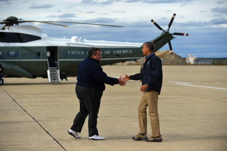 <p>US President Barack Obama (R) is greeted by New Jersey Governor Chris Christie upon arriving in Atlantic City, New Jersey, on October 31, 2012 to visit areas hardest hit by the unprecedented cyclone Sandy. Americans sifted through the wreckage of superstorm Sandy on Wednesday as millions remained without power. The storm carved a trail of devastation across New York City and New Jersey, killing dozens of people in several states, swamping miles of coastline, and throwing the tied-up White House race into disarray just days before the vote.</p>