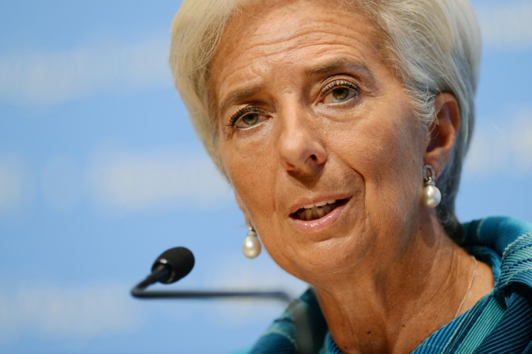 <p>IMF managing director Christine Lagarde answers questions at a press conference during the annual meetings of the IMF and the World Bank in Tokyo on Oct. 11, 2012.</p>