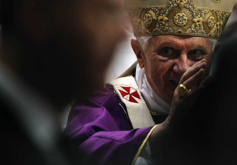 <p>Pope Benedict XVI waves as he leaves after celebrating the mass in memory on March 29, 2010.</p>